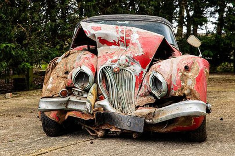 Crumpled old car kept in garage for 25 years after tree crash sells for fortune